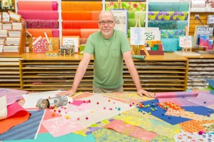 Greg at the paper counter at Wet Paint